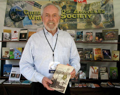 "David Collns, author of Shanghaied"" at Greater Los Angeles Writers Society (GLAWS) booth at recent LA Book Festival."